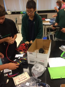 Students working with their electric motor kits